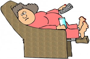 Woman in recliner with TV remote